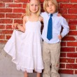 Happy children hugging and smiling. Beautiful blond girl and boy — Stock Photo