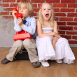 Stock Photo: Emotions children. boy call on phone, girl screams