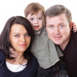 Happy family. Father, mother and boy. Over white background — Stock Photo