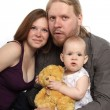 Beautiful family looks at camera. Father, mother and child isola — Stock Photo