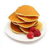 Small pancakes topped with berries isolated on white — Stock Photo