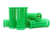 Green curlers isolated on a white background — ストック写真
