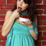 Beautiful woman eating cherry — Stock Photo