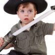 A young boy dressed as a pirate. - Stock Photo