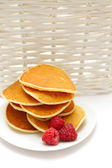 Small pancakes topped with berries isolated on white. Food backg — Stock Photo