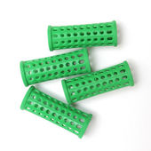 Green curlers isolated over white. Top view — Stock Photo