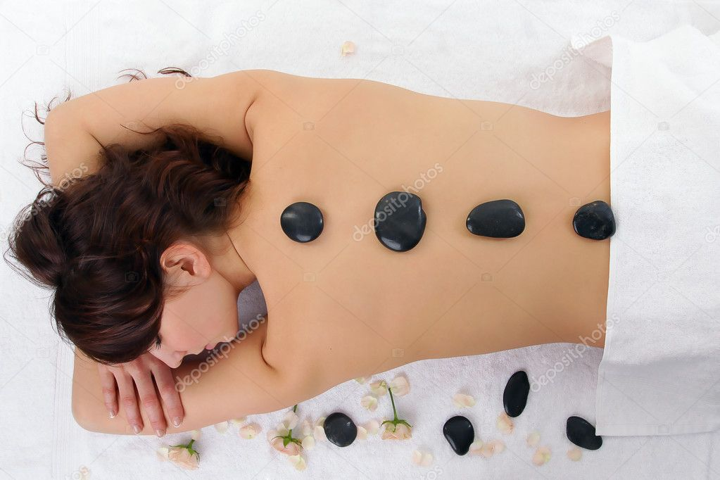 Woman getting spa treatment isolated on white. Massage with hot stone — Stock Photo #3620511