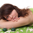 Portrait of fresh and beautiful brunette woman laying on green t — Stock Photo