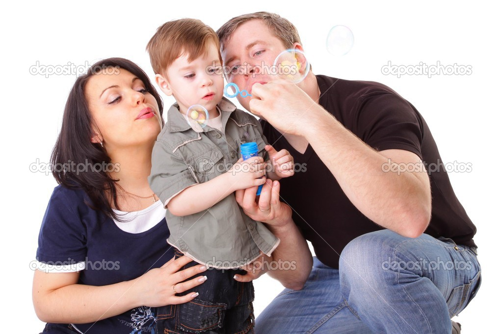 Happy family having fun. Man, woman and child blow bubbles. Series  Stock Photo #3724167