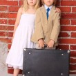 Little bride and groom with copyspace on suitcase. Honeymoon. Se — Stock Photo