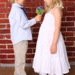 Little boy gives a girl a beautiful bouquet of flowers. Love con — Stock Photo