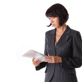 Business woman reading a newspaper — Stock Photo