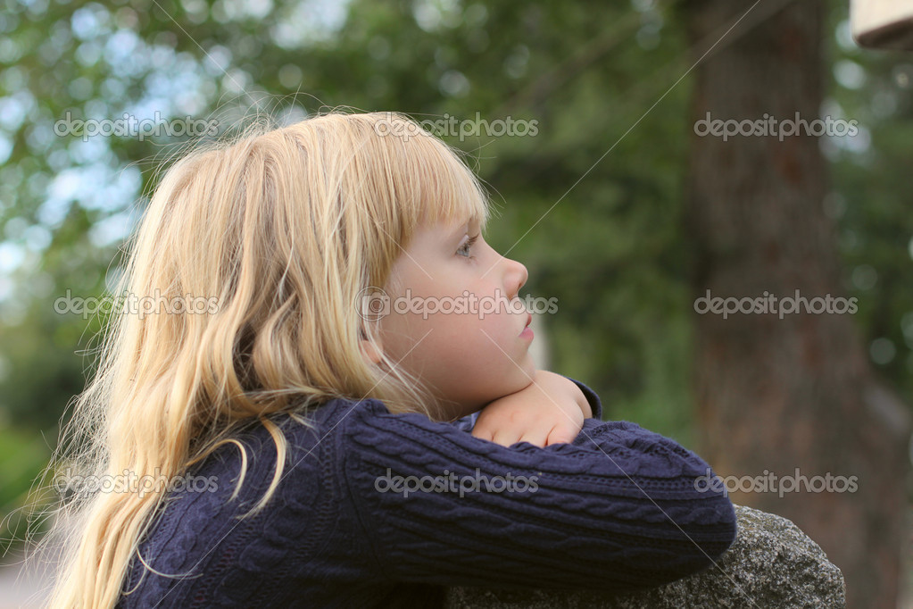 Adorable little girl taken closeup outdoors  Stock Photo #3857476
