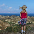 Girl looks at the beautiful sea, beach and mountains in Greece - Stock Photo