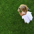 Sreen grass background and girl — Stock Photo