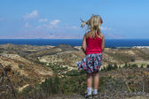 Girl looks at the beautiful sea, beach and mountains in Greece — Stock Photo