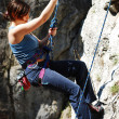 Woman rappelling — Stock Photo