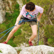Climber rappelling — Stock Photo