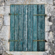 Blue window shutter — Stockfoto