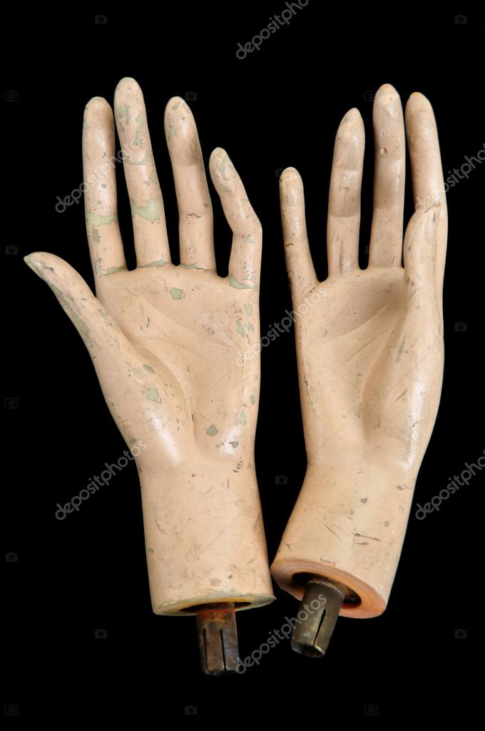 Weathered severed hands of plastic mannequin doll.  Stock Photo #3872513