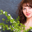The Girl with a green branch - Stock Photo