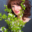 The Girl with a green branch — Stock Photo