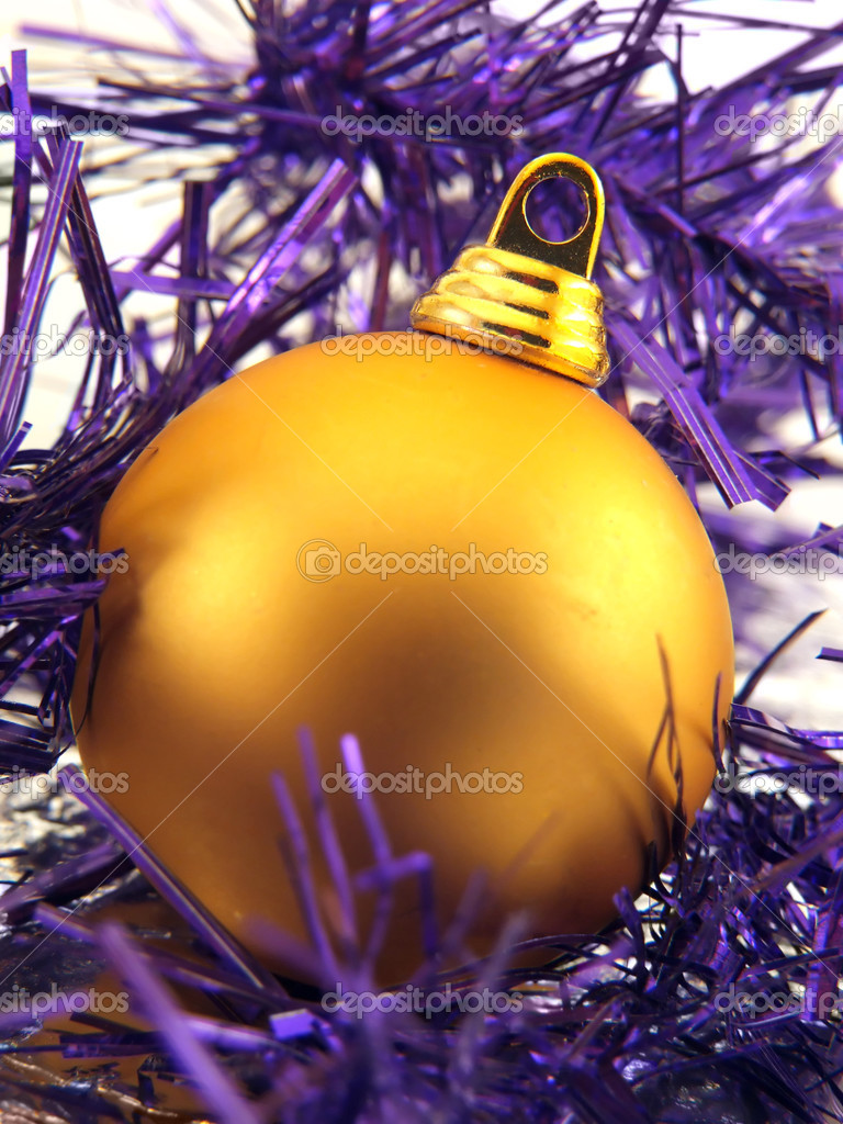 Golden christmas ornament in violet decorative ribbon — Stock Photo #3906742
