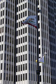 Flag on California and skyscrapers — Stock Photo