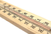 Wooden thermometer on white background — Stock Photo