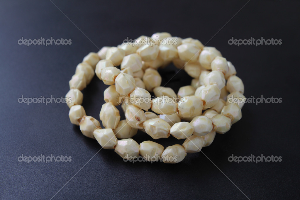 Necklace with yellowis stones on dark background  Stock Photo #3005803