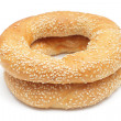Stock Photo: Two bagels with sesame seeds isolated on white