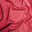 Texture of a dark red satin silk — Stock Photo