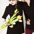 Lovers with bouquet of tulips — Stock Photo