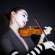 Woman mime in white gloves who plays the violin — Stock Photo #3385719