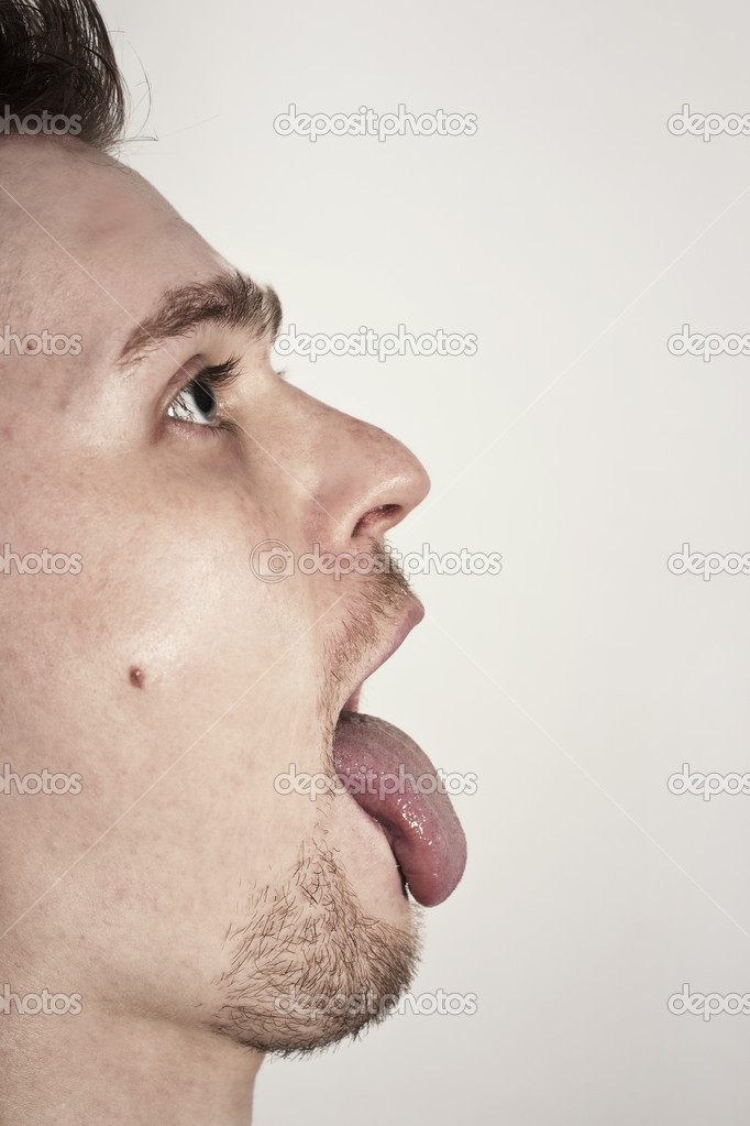Guy with mouth wide opened showin tongue  Stock Photo #3416865