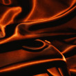 Texture of a black silkcloth red satin  silk close up — Stock Photo