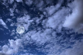 Night landscape with the moon, clouds and stars — Stock Photo