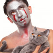 Young man with silver makeup on his face and cat isolated — Stock Photo