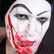 Mime with blood on face — Stock Photo #3527543