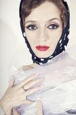Beautiful woman wearing headscarf polka dot — Stock Photo