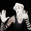 Mime in striped gloves and white hat — Stock Photo #3552372