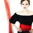 Stock Photo: Womin black dress with red sash on white background