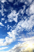 Summer blue sky with sun and clouds — Stock Photo