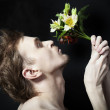 Young men sniffing bouquet of flowers — Stock Photo