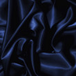 Texture of a dark blue silk - Stock Photo