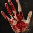 Human hand with blood - Stock Photo