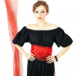 Stock Photo: Womin black dress with red sash