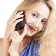Stock Photo: Young blond womtalking by phone