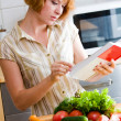 Girl reads a cookbook — Stock Photo #3469471