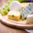 Cheeses with white grapes — Stock Photo